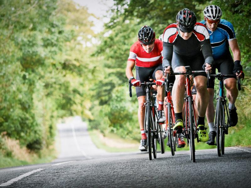 Men in lyrca on bikes